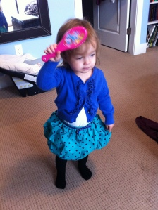 Georgie dolls herself up.